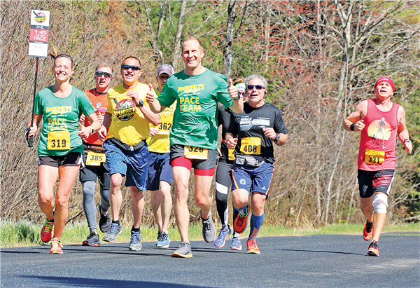 A group of runners participating in the half-marathon.
