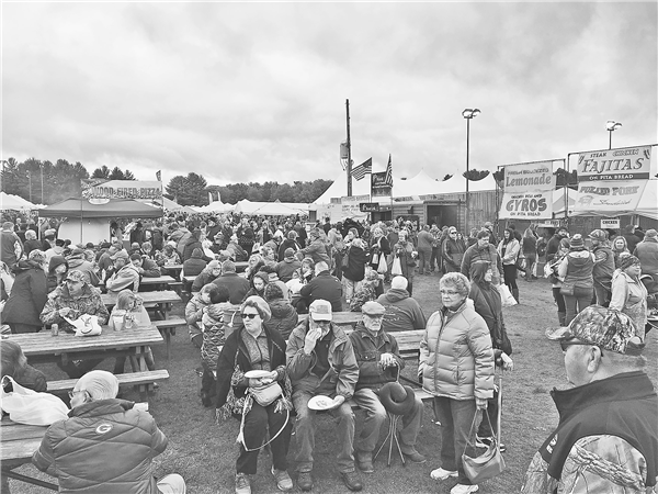 Gloomy skies didn't stop tens of thousands of people from attending the 39th annual Cranberry Fest in Eagle River Saturday and Sunday. This was the scene Saturday as people gathered near the food vendors. —STAFF PHOTOS