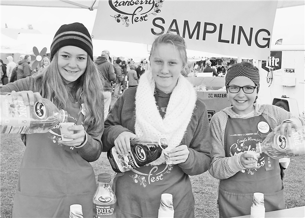 Chamber officials say volunteers are a key to a successful Cranberry Fest. Serving a variety of cranberry juices were volunteers, from left, Emily Reid, Emilie Walloch and Olivia Reid, all from Northland Pines SOAR Charter School.