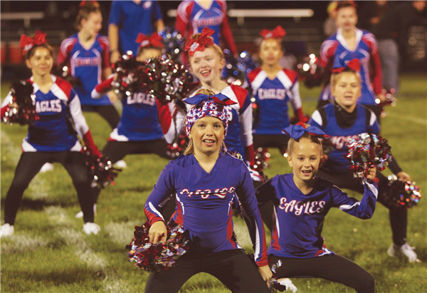 Youth cheerleaders who participate in the Northland Pines Youth Football and Cheerleader program entertained during the halftime of a recent Eagles varsity football game. —Staff Photo By GARY RIDDERBUSCH