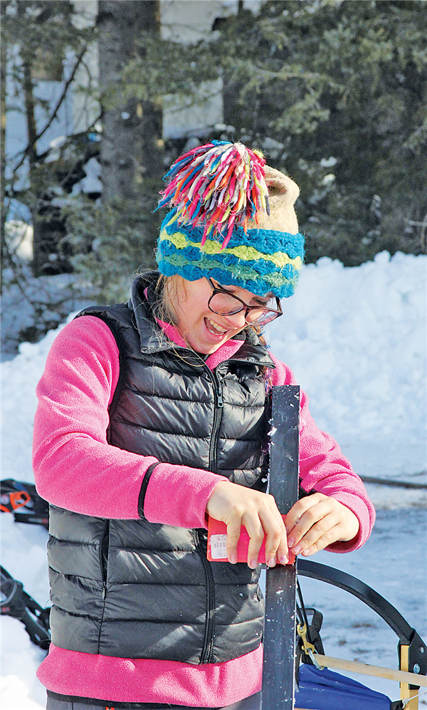 A competitor changing the wax on a sled ski on a warm Saturday in Land O' Lakes.