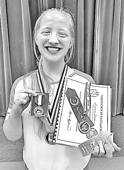 Eighth-grade SOAR student Alyssa Imse displays her various awards. —Contributed Photo