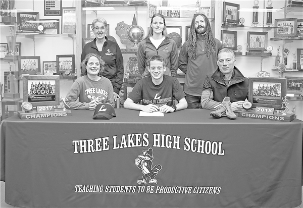 Jared Zwettler will run track with UW-La Crosse this year. Taking part in the signing were, front row from left, Zwettler's mother Amy, Zwettler and his father, Rob; and back row, coaches Laurie Levandoski and Jayme Wyss and Andy Wyss. —Photo By Jennifer West