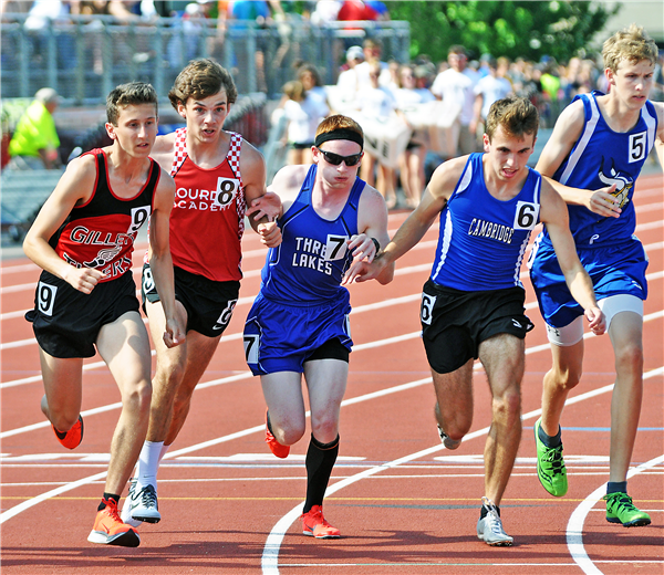 Jared Zwettler (No. 7) takes off from the start line during the 1,600-meter race at the 2018 WIAA State Track & Field Championships held in La Crosse. —Staff Photo By DOUG ETTEN