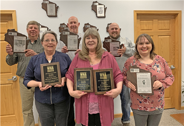 Displaying the News-Review's first-place plaques are staffers, front row from left, Jo Daniel, Betsy Boulden and Toni Ruthven; and back row, Gary Ridderbusch, Kurt Krueger and Doug Etten. —Staff Photo By JEAN DREW