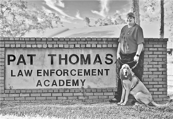 Kimberly Maney and her bloodhound, Reba, trained at the Pat Thomas Law Enforcement Academy in Tallahassee, Fla., to certify Reba for Advanced level searches. —Contributed Photo