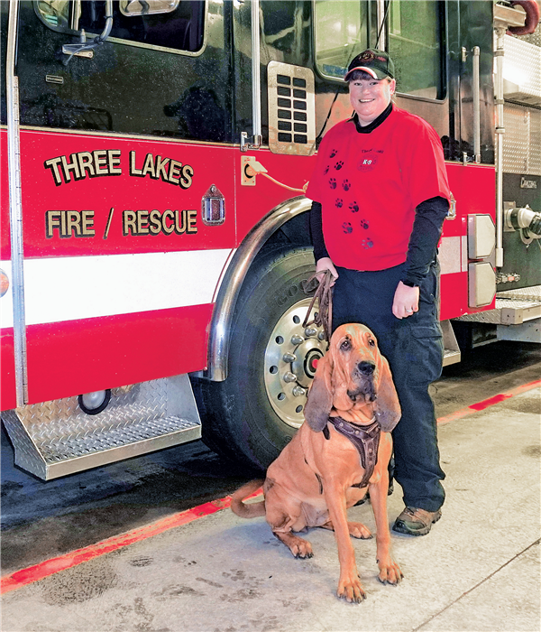 Kimberly Maney of the Three Lakes Fire Department is ready for searches with her bloodhound Reba. —Photo By Kerry Griebenow