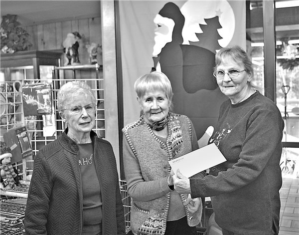 Thrift Shop volunteers from left, Lorel Ingram, Betty Schufelt and Rhonda Coker prepare to drop a $600 donation in the mail to Marshfield Clinic Breast Care Fund. While working in the shop volunteers wear masks and observe the 6-foot social distancing rule. The organization provides hand sanitizer and other COVID-19 protections at the entry to the store. —Photo By Wally Geist